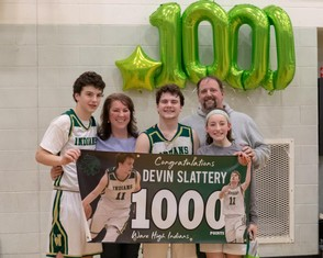 Dillon, Julie, Devin, Scott, and Madisyn Slattery celebrate after Devin scored his 1000th point. (Photo submitted by Michael Brown)
