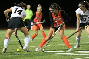 The Agawam and Longmeadow Field Hockey teams, from a prior game, finish in a 1-1 tie Monday night. (DOUG STEINBOCK / MASSLIVE)