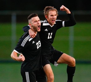 Northwestern Lehigh's Caleb Danner (#23) and Sam Seyfried celebrate the Tigers' first goal against Moravian Academy. (Saed Hindash   For lehighvalleylive.com)