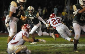 Emmaus quarterback Ethan Parvel avoids pressure from Dominic Falcone. (Chris Shipley | lehighvalleylive.com contributor)