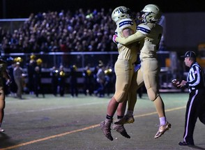 West Genesee players celebrate a touchdown vs. Christian Brothers Academy in the Section III Class AA quarterfinals at West Genesee High School in Camillus, N.Y., Friday Oct. 19, 2018. (Scott Schild | sschild@syracuse.com)