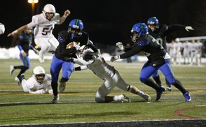 JaiQuawn McGriff (7) scores his second touchdown of the night for Cicero-North Syracuse. The TD pulled the Northstars to within seven points, but that's as close as they'd come in a 28-21 loss to Rochester Aquinas. (Even Whitney photo)