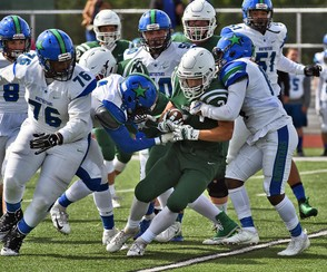 Fayetteville-Manlius' Zach Page is smothered by the Cicero-North Syracuse defense during a game on Saturday, Sept. 22, 2018. (Michael Greenlar | mgreenlar@syracuse.com)