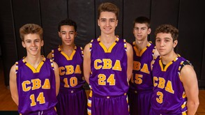 Aaron Clendenin (center) and Nick Valenti (far right) combined for 23 points in Christian Brothers Academy's 57-54 upset of the Syracuse Academy of Science on Friday. (Photo by N. Scott Trimble)
