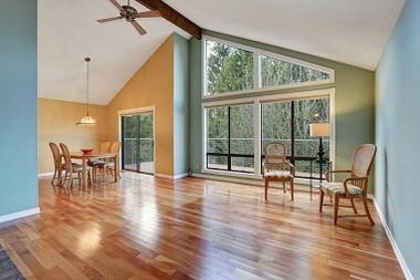 Large Dinning Area With Hardwood Floor.