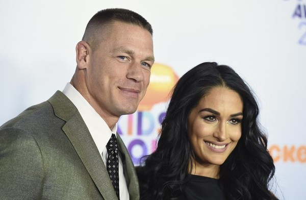 AP FILE -- John Cena, left, and Nikki Bella(AP)