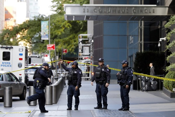 New York City Police Dept. officers arrive outside the Time Warner Center, in New York, Wednesday, Oct. 24, 2018.