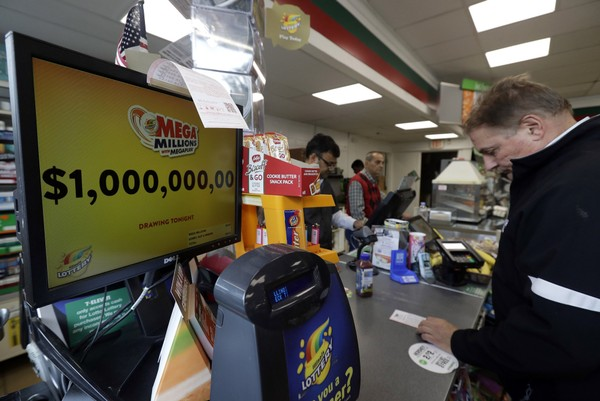 A sign displays the estimated Mega Millions jackpot at a convenience store in Chicago, Friday, Oct. 19, 2018.  (AP Photo/Nam Y. Huh)
