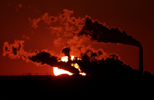 In this March 8, 2014 file photo steam from the Jeffrey Energy Center coal-fired power plant is silhouetted against the setting sun near St. Marys, Kansas. (AP Photo/Charlie Riedel, File)(Charlie Riedel)