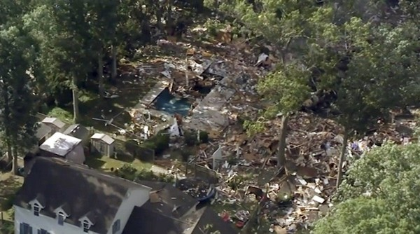 This aerial image taken from video provided by WPVI shows debris covering the ground after a house exploded on Saturday, July 7, 2018 in Newfield, N.J. The blast reduced the two-story home to a pile of rubble, killing two people. (WPVI via AP)