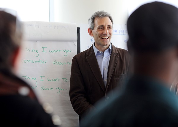 "John Sarrouf, Essential Partner's director of program development, works with participants at the ""Guns: An American Conversation"" workshop in March in Washington, D.C. Twenty-one people from across the political spectrum met to discuss gun-related issues."