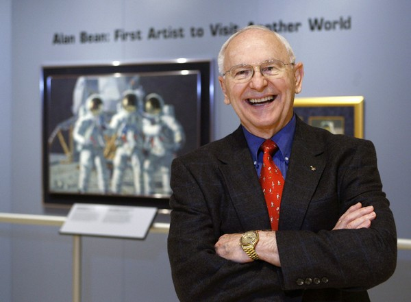 In this Oct. 1, 2008, file photo, Alan Bean, the fourth man to walk on the moon, is shown during a preview of his work at the Lyndon Baines Johnson Library and Museum in Austin, Texas.