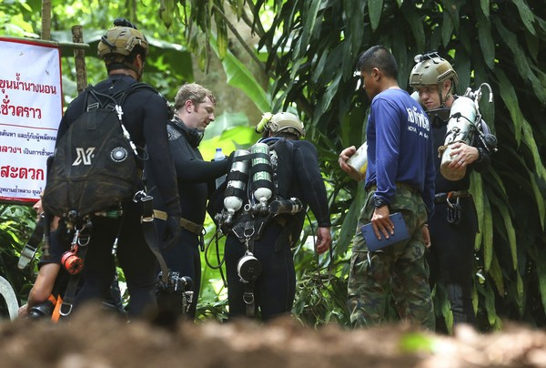 International rescuers team prepare to enter the cave where a young soccer team and their coach trapped by flood waters Thursday, July 5, 2018, in Mae Sai, Chiang Rai province, in northern Thailand.