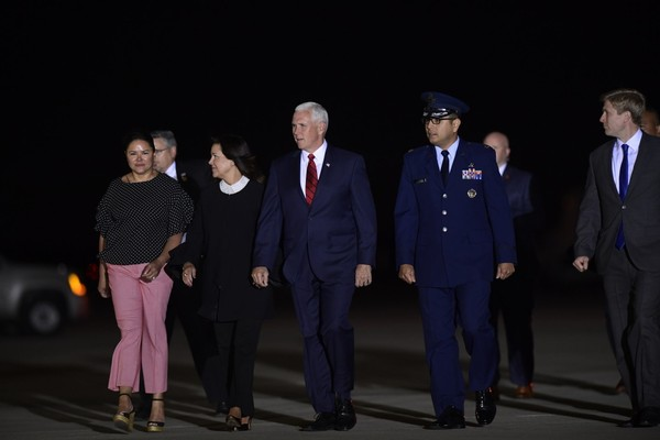 Vice President Mike Pence, center, and his wife Karen, center left, arrive at Andrews Air Force Base in Md., to greet the three Americans detained in North Korea for more than a year, Thursday, May 10, 2018. (AP Photo/Susan Walsh)