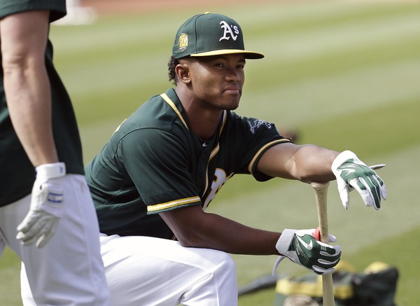 In this June 15, 2018 photo, Oakland Athletics draft pick Kyler Murray waits to hit during batting practice before a baseball game between the Athletics and the Los Angeles Angels in Oakland, Calif. (AP Photo/Jeff Chiu, File)