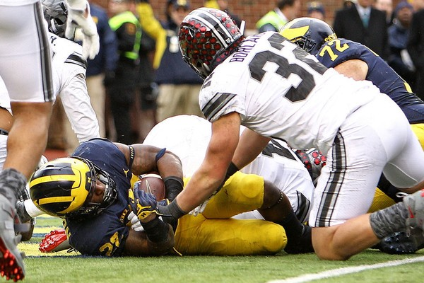 Michigan running back Karan Higdon (22) dives in for a touchdown in the third quarter against Ohio State at Michigan Stadium in Ann Arbor, on Nov. 25, 2017. Ohio State won the game, 31-20.