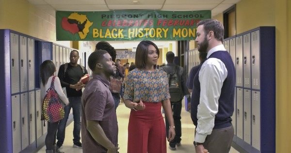 "This image released by Universal Pictures shows Kevin Hart, from left, Tiffany Haddish and Taran Killam in a scene from the film, ""Night School."""