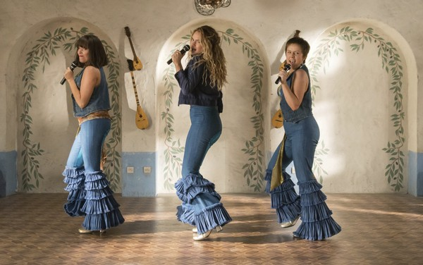 """This image released by Universal Pictures shows, from left, Jessica Keenan Wynn, Lily James and Alexa Davies in a scene from """"Mamma Mia! Here We Go Again."""" (Jonathan Prime/Universal Pictures via AP)"""