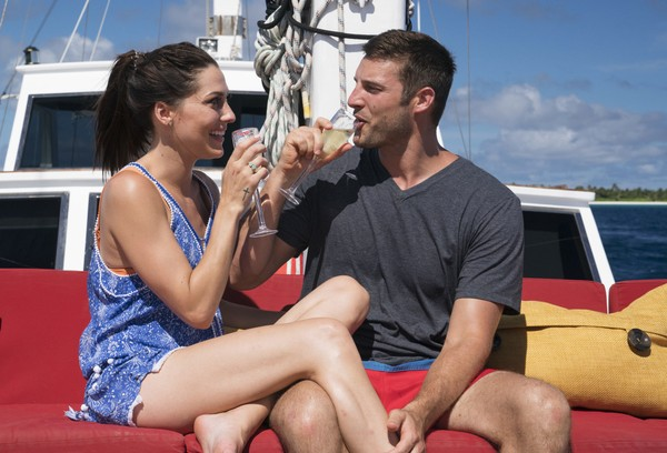 "In this undated photo provided by ABC, Becca Kufrin drinks with Garrett Yrigoyen in an episode of the ""The Bachelorette."" (Paul Hebert/ABC via AP)"