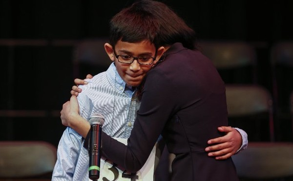 Christopher Serrao is hugged by his older sister, Danielle, after winning the 2017 Discover Lehigh Valley Regional Spelling Bee on March 16, 2017, at Northampton Community College. (Saed Hindash | For lehighvalleylive.com)