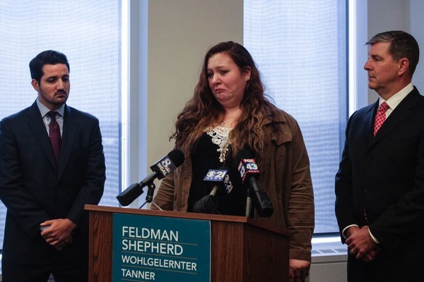 Jessica Lyband with her attorneys Mark Tanner (right) and James Faunes (left) with the Feldman, Shepherd, Wohlgelernter, Tanner, Weinstock and Dodig LLP in Philadelphia. Lyband's husband and 16-month-old daughter were killed in a 12-vehicle car crash on I-83 near Union Deposit Road on Oct. 12. It was her 21st birthday. (Julia Hatmaker | For pennlive.com)