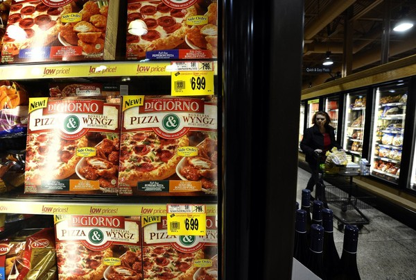 A woman strolls down the frozen foods aisle at a Wegmans store in Fairfax, Virginia, on Feb. 24, 2011. (JEWEL SAMAD/AFP/Getty Images, File)