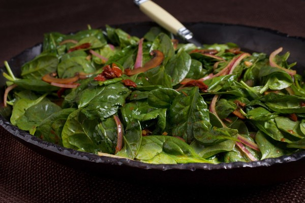 Did you know adding a dish like this warm spinach salad with mushrooms and sun-dried tomatoes to a meal could help lower your blood pressure? (Photo by Deb Lindsey for The Washington Post)