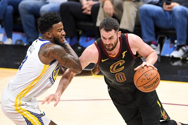f43779a26916 Kevin Love of the Cleveland Cavaliers drives to the basket defended by  Jordan Bell of the