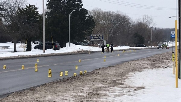 Dozens of evidence markers lined a stretch of Route 5 in Oneida Monday morning after an unarmed man died after being struck twice with Tasers fired by police officers. Police said the man was violent and uncooperative in the middle of Route 5. The Attorney General's Office is investigating.