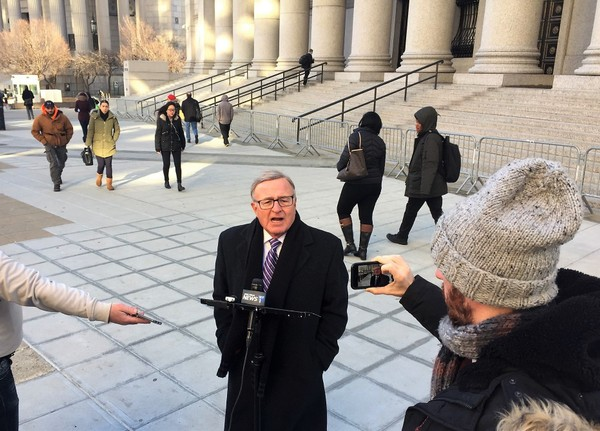 State Sen. John DeFrancisco, R-DeWitt, speaks to the media outside the U.S. Courthouse in Foley Square in Manhattan on Thursday, Feb. 8, 2018, before the testimony resumed in a corruption trial of a former top aide to Gov. Andrew Cuomo.