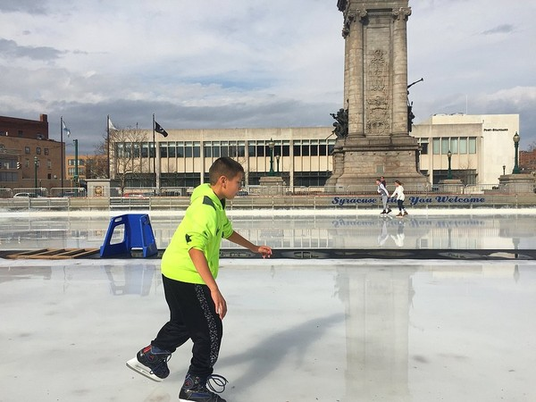 In this Feb. 20 file photo, Kaiden Hines, 10, of Liverpool, skates at the Clinton Square skating rink in Syracuse, which set a record high that day of 68 degrees.