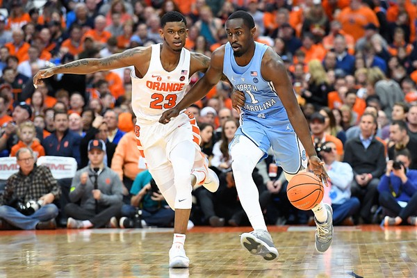 North Carolina guard Theo Pinson is defended by Syracuse guard Frank Howard during a game on Wednesday, Feb. 21, 2018, at the Carrier Dome.
