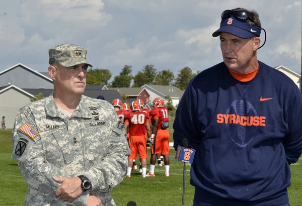 File photo, 2012: Fort Drum commander Major Gen. Mark A. Milley and former SU football coach Doug Marrone during press conference at Fort Drum, NY.  Marrone and his wife will attend a fundraiser in June 2018 for Clear Path for Veterans.