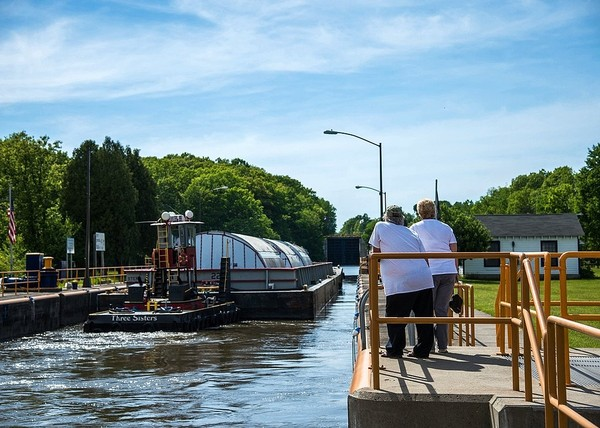 Spectators watch a large beer tank headed to the Genesee Brewery in Rochester at the New York State Canal System lock in Waterford in June 2017. The tanks' journey to the brewery was a highlight of the 2017 canal system season.