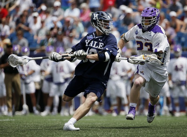 Albany's Jack Burgmaster (23) defends against Yale's Jack Tigh during the first half in the semifinals of the NCAA Division 1 college lacrosse tournament in Foxborough, Mass., Saturday, May 26, 2018. (AP Photo/Michael Dwyer)