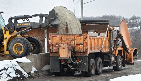 Snow plows take on salt to apply on roads in this 2012 file photo. Road salt is being blamed for contamination of wells and lakes in the Adirondacks.(David Lassman | The Post-Standard)