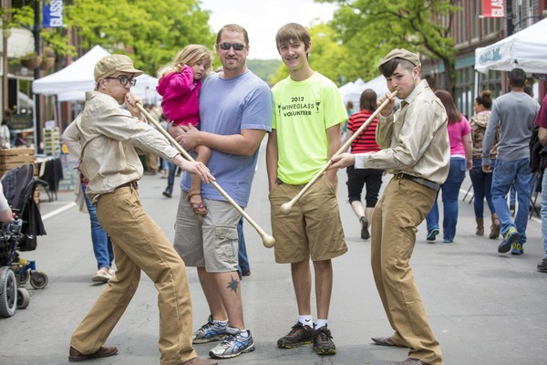 The Golden Gaffers pose with a family at the Corning GlassFest. (Courtesy of Cagwin Photography)