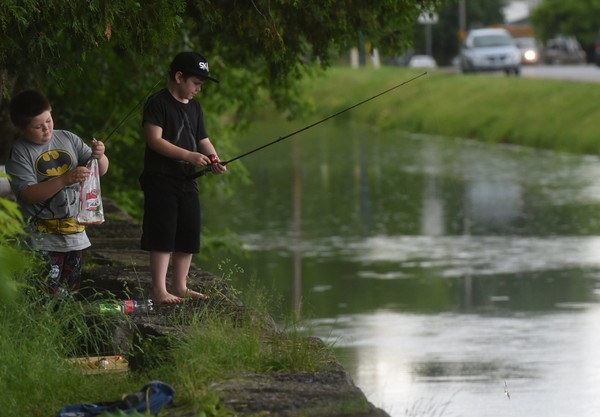 Boys fishing the old Erie Canal in Canastota, NY.