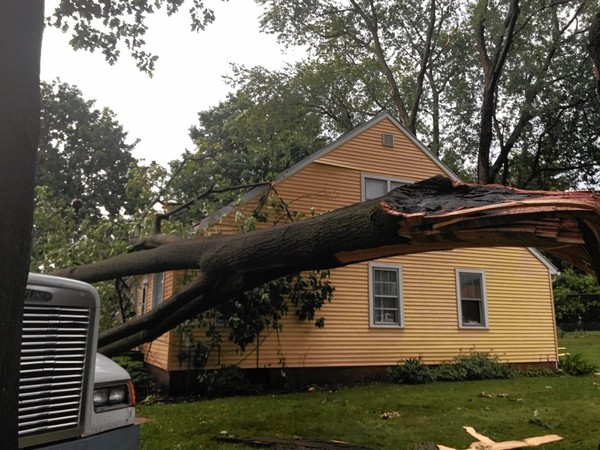In this 2016 file photo, a large tree knocked over by strong winds damaged a house in Clinton. Severe thunderstorms are possible Wednesday in Upstate New York.