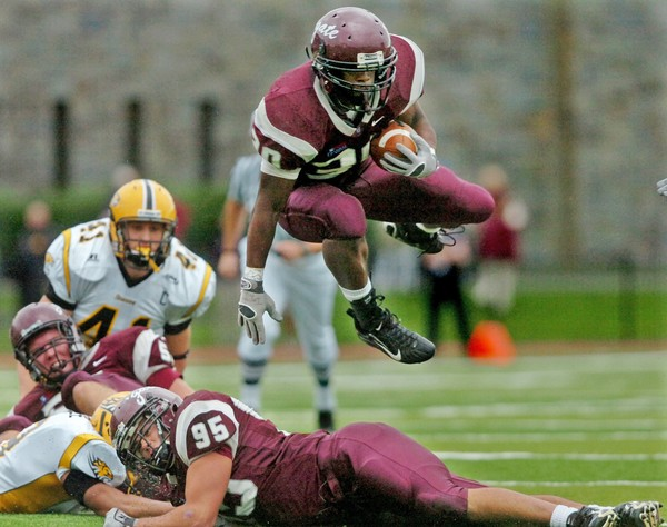 Colgate tailback Jordan Scott jumps over teammate Adrien Schriefer to pick up a first down in the first quarter of a game on October 19, 2007, at Andy Kerr Stadium in Hamilton.
