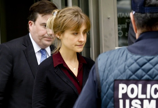 Actress Allison Mack, center, leaves after a hearing in Brooklyn Federal Court, Friday May 4, 2018, in New York.