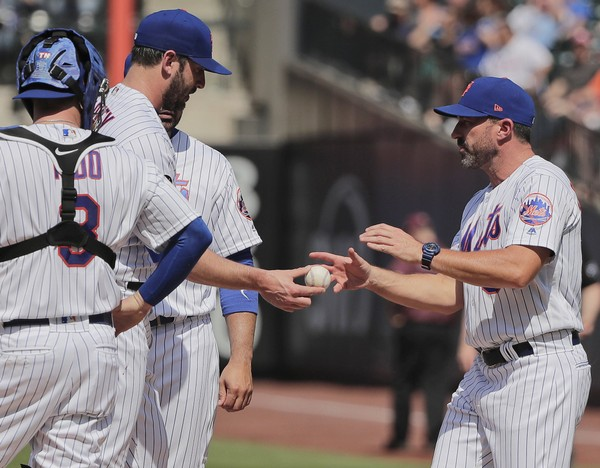 In this Thursday, May 3, 2018, file photo, New York Mets pitcher Matt Harvey, second from left, hands the ball to manager Mickey Callaway as he is relieved in the seventh inning of a baseball game against the Atlanta Braves in New York. Mets general manager Sandy Alderson said Friday, May 4, 2018, that the 29-year-old right-hander refused a minor league assignment and will designated for assignment Saturday.