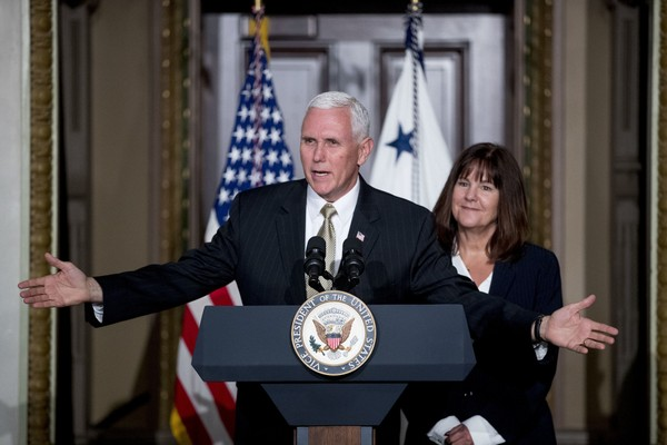 Vice President Mike Pence, accompanied by his wife Karen Pence, right, speaks at a reception for the Organization of American States in Washington, Monday, June 4, 2018. (Andrew Harnik | AP Photo)