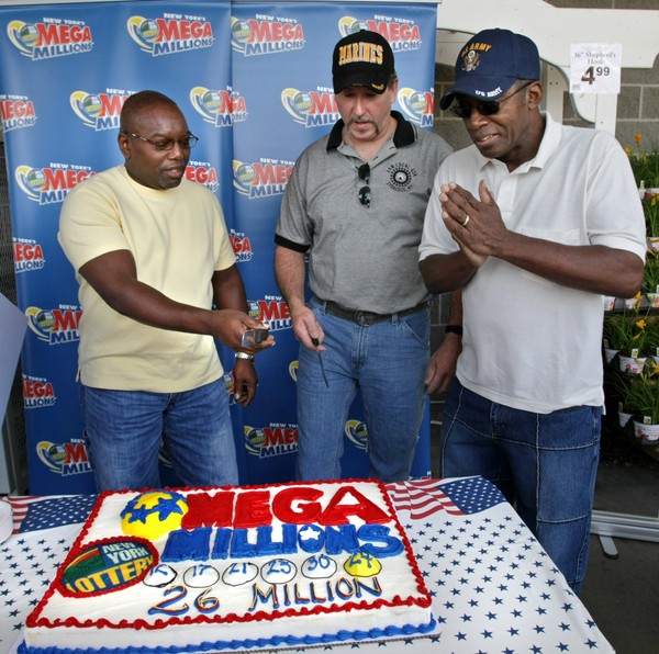 NYS Lottery Mega Millions $26 million dollar winners cut a cake at the Price Chopper store on Erie Boulevard in Syracuse in 2010.  The three are employees at New Process Gear in East Syracuse.  L-R; Ronald Edwards of Syracuse, Douglas Tedford of Canastota and Freddie Hands of Syracuse.