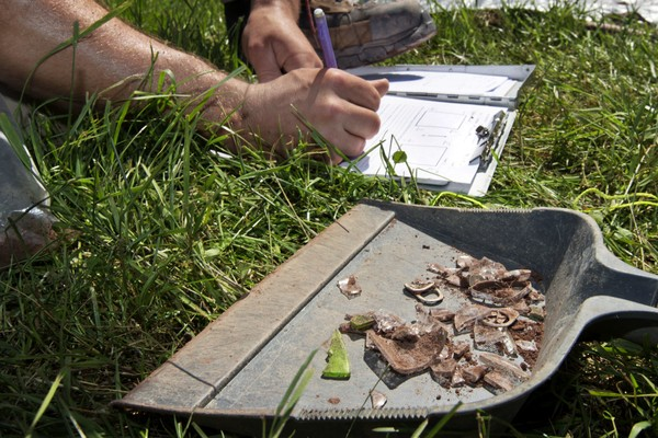 In this Thursday, June 14, 2018 photo, collected artifacts from a dig are recorded at the site of the original Woodstock Music and Art Fair, in Bethel, N.Y. The main mission of Binghamton University's Public Archaeology Facility was to help map out more exactly where The Who, Creedence Clearwater Revival, Janis Joplin and Joe Cocker wowed the crowds 49 years ago.