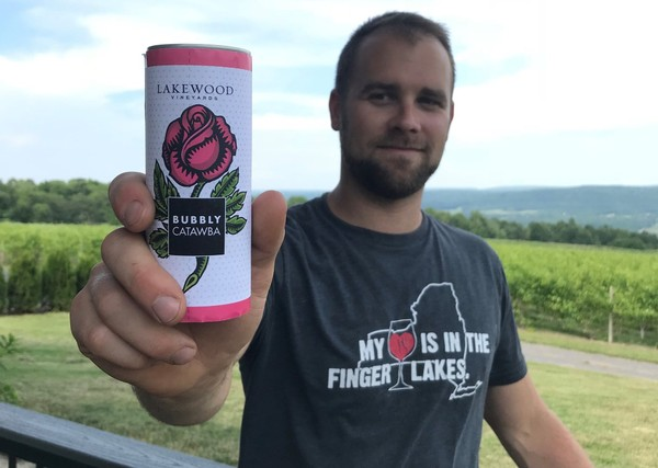 Ben Stamp of Lakewood Vineyards on Seneca Lakes holds a can of Bubbly Catawba, the winery's first product to be packaged in a can. Lakewood Vineyards(Lakewood Vineyards)