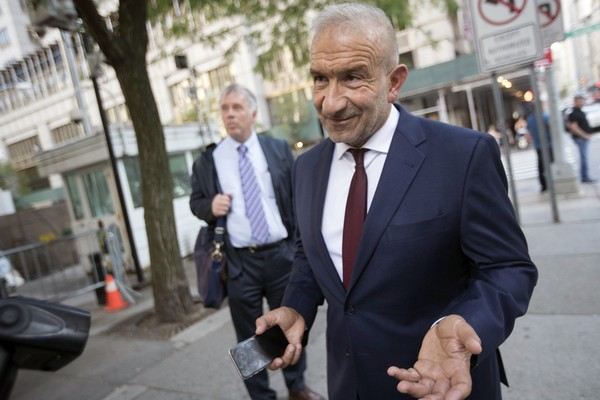 "Alain Kaloyeros, foreground, leaves federal court in New York, Thursday, July 12, 2018. A federal jury convicted Kaloyeros and three other defendants of corruption in Gov. Andrew Cuomo's ""Buffalo Billion"" economic redevelopment program. (AP Photo/Mary Altaffer) AP(Mary Altaffer)"
