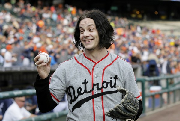 Musician Jack White shows off a baseball before throwing out the ceremonial first pitch before the Detroit Tigers baseball game against the Chicago White Sox Tuesday, July 29, 2014, in Detroit. (Duane Burleson | AP)