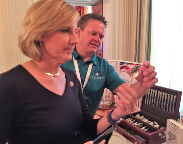 U.S. Rep. Claudia Tenney shows a Chinese-made spoon used by guests at the White House to Matt Roberts, president of Sherrill Manufacturing, at the Made in America Product Showcase at the White House, Monday, July 23, 2018.