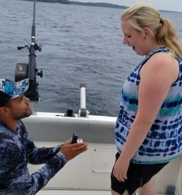 Troy Ray McMullen pops the question to his girlfriend, Laura Blaisdell. Both live in Auburn.